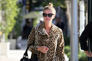 Socialite Nicky Hilton seen with a smile as she leaves an office building in Beverly Hills, CA.