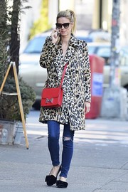 Nicky Hilton's coral Hermes Constance satchel and leopard-print fur coat were a luxurious pairing!