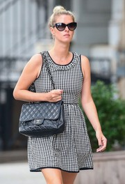 Nicky matched this pair of chic cateye sunglasses with her black and white dress.