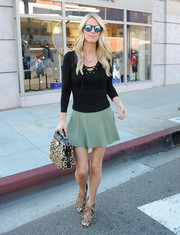 Nicky Hilton styled her outfit with a pair of leopard-print lace-up booties by Alaia.
