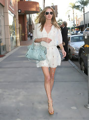 Nicky Hilton accessorized her ensemble with platform strappy sandals.