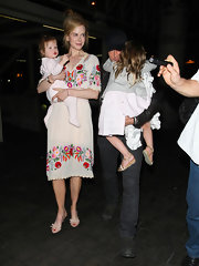 Nicole Kidman wore an adorable pair of mules featuring sweet little bows while traveling with her family.