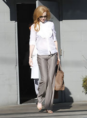 Nicole Kidman was simply chic in tailored trousers and nude peep-toe pumps.