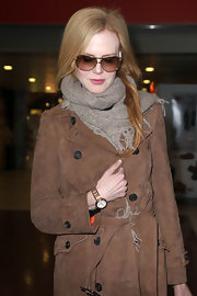 Nicole Kidman wore her hair swept over her shoulder while arriving in Paris.
