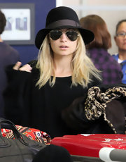 Nicole donned a cute floppy hat for her flight at LAX.