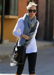 Nicole Richie added flair to her workout look with a studded leather purse.