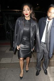 Nicole Scherzinger enjoyed a night out in London wearing a little black leather dress with a ribbed bodice.