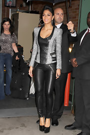 Nicole Scherzinger paired her rocker-chic outfit with classic black platform pumps.