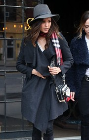 Nina Dobrev styled a plain gray coat with a printed shoulder bag by Rebecca Minkoff for a day out in New York City.