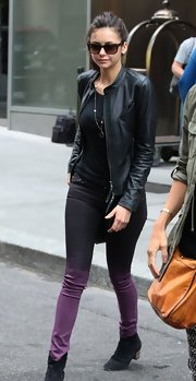A classic leather jacket topped off Nina Dobrev's chic and edgy street style.