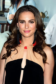 Natalie Portman accentuated her eyes with dramatic false lashes.