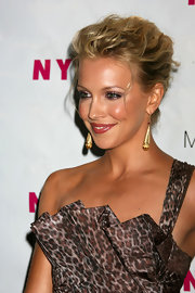 Katie Cassidy rocked dangling gold earrings at the Nylon magazine launch party.