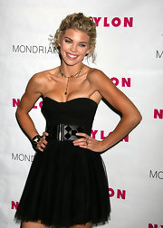 At the TV launch party for Nylon, she is wearing a black mini with a black studded belt. Great piece for adding detail and character to this dress.