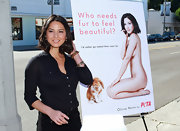 Olivia Munn unveiled her new PETA ad in a simple, yet sophisticated black button up shirt.