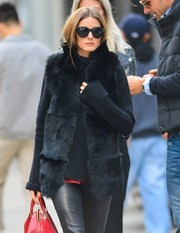 Olivia Palermo showed off her fall style with a black fur vest layered over a sweater while out and about in New York City.