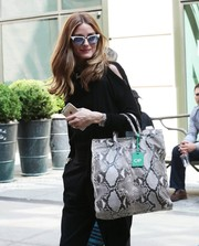 Olivia Palermo topped off her look in cool style with a pair of modernized cateye sunnies by Westward \\ Leaning.