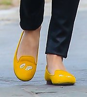 Olivia Palermo slipped on a monogrammed pair of smoking slippers while out and about in NYC.