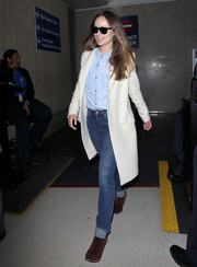 Olivia Wilde took a flight to LAX dressed down in jeans and a blue button-down shirt.