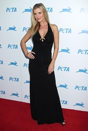 Joanna steamed up the red carpet in a black halter dress with a peekaboo neckline.