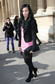 Leigh Lezark came out to paris Fashion week looking ready for spring in her hot pink frock. She toned it down with a black cropped jacket and leather clutch.