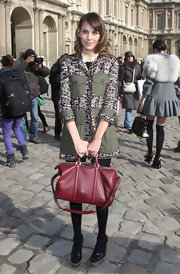 Style Maven Alexa Chung made another stop on the Fashion Week trail and came out to the Louis Vuitton Show carrying a burgundy tote.