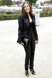 Melanie Bernier paired her leather pants with a sequin blazer to spruce her look up.