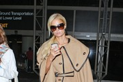 Socialite Paris Hilton is pictured arriving at Los Angeles International Airport (LAX)