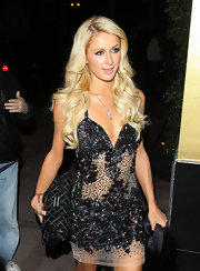 Paris Hilton added elegance to her glitzy cocktail dress with a quilted leather clutch.