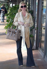 Kathy Hilton added some flair to her casual outfit with a gauzy silk scarf.