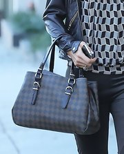 Paris Hilton carried a Louis Vuitton tote to her hair salon.