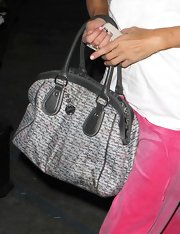 Paris showed off one of her tote bags from her own designer collection. Good self promotion.