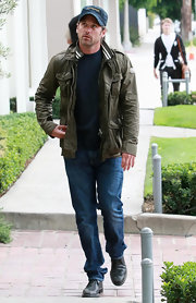 Patrick Dempsey dressed up his casual jeans with an army green track jacket.