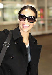 Paula Patton wore a pair of black rectangular shades for her trip to the airport.