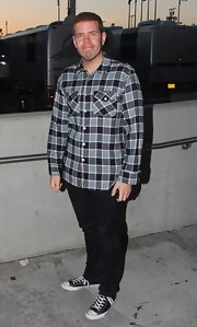 Perez Hilton took a break from his outrageous outfits and wore this neutral button-down and jeans combo to Britney Spears' concert.
