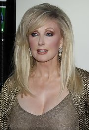 Morgan Fairchild paired elegant dangling pearl earrings with her shimmery outfit for a totally glamorous finish.