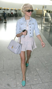 Pixie Lott wore this pale denim jacket with a darling romper at the airport in London.