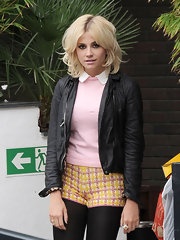 Pixie Lott toughened her flirty school girl style Peter Pan top with a leather jacket.