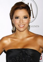 Eva paired her black strapless dress with silver hoop earrings.