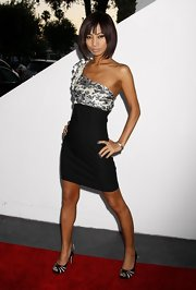 Bai Ling paired her black and white cocktail dress with striped, peep toe pumps.