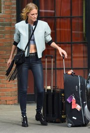 Poppy Delevingne was spotted outside the Bowery Hotel sporting a bomber jacket embroidered with her initials.