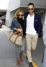 Chris wears slim fitting khaki pants with this stylish casual look.