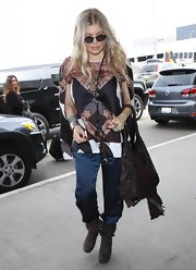 Fergie chose this silk paisley-print blouse with open sleeves for her bohemian-inspired travel look.