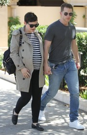 Ginnifer Goodwin stepped out for lunch wearing black leggings, a striped shirt, and a taupe trenchcoat.