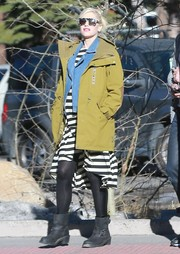 Gwen Stefani toughened up in an olive-green utility jacket and black moto boots while vacationing in Mammoth.