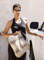 We love Halle's snake skin textured tote