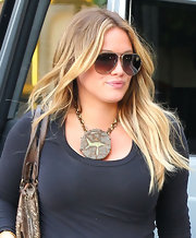 Hilary Duff wore her hair in tousled natural waves while out in Beverly Hills.