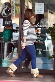 Hilary Duff showed off her expanding form in a tight nautical striped T-shirt.