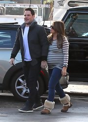 A pregnant Hilary Duff kept comfy in a striped sweater and tan sheepskin boots.