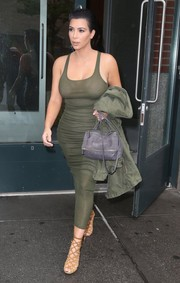 Kim Kardashian put her crazy curves on show in a tight green tank dress by Faith Connexion as she headed to the airport.