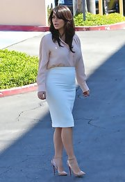 Kim Kardashian kept her look light and bright with this pink pastel button down blouse.